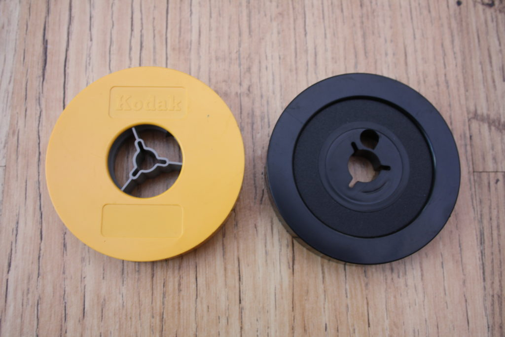"Iconic 3"" yellow Regular 8 & black Super 8 reels"
